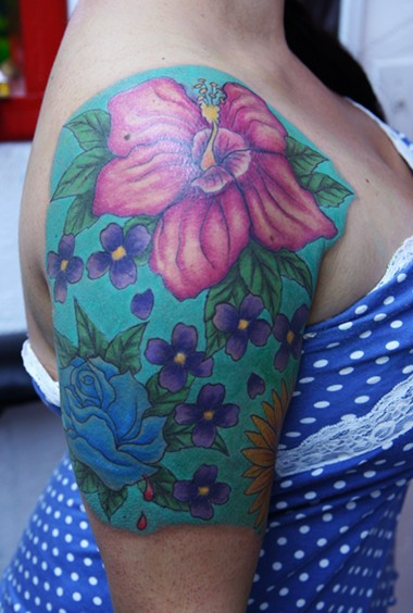 Flower Tattoo on arm Girl