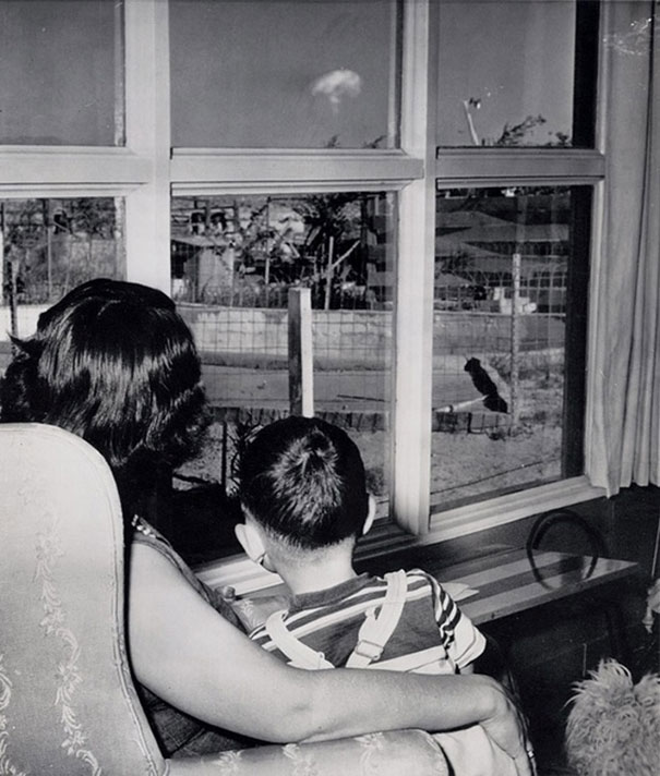 Mom and son watching the mushroom cloud after an atomic test, Las Vegas, 1953